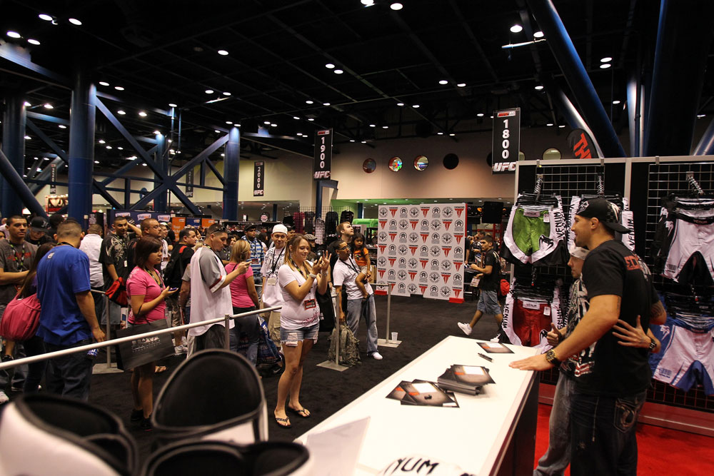 Fans line up to take pictures and get autographs from UFC fighter Brendan Schaub