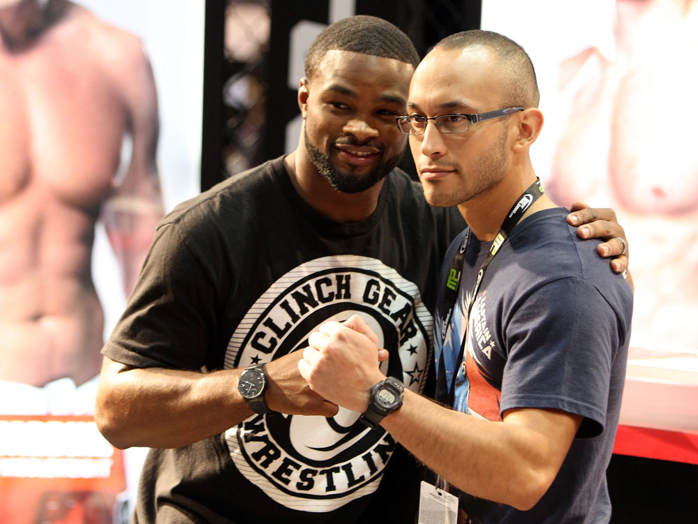 Strikeforce welterweight fighter Tyron Woodley poses for a photo with a fan