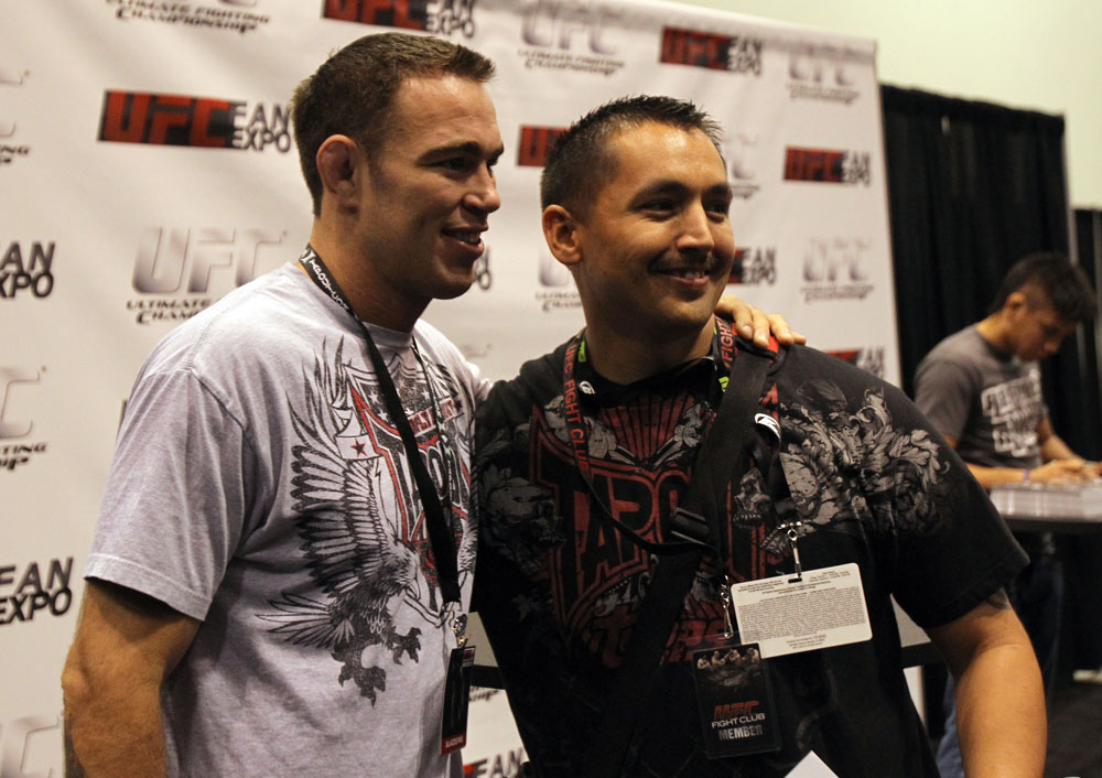 Jake Shields poses for a photo for a fan