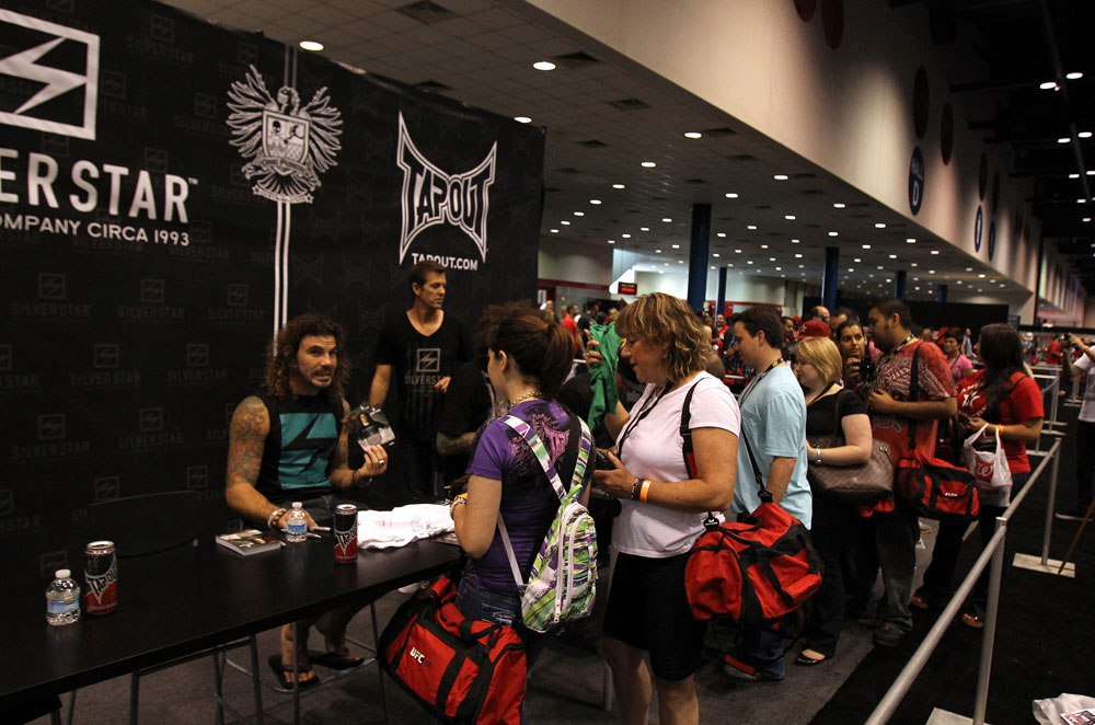 UFC Fighter Clay Guida signs autographs for fans
