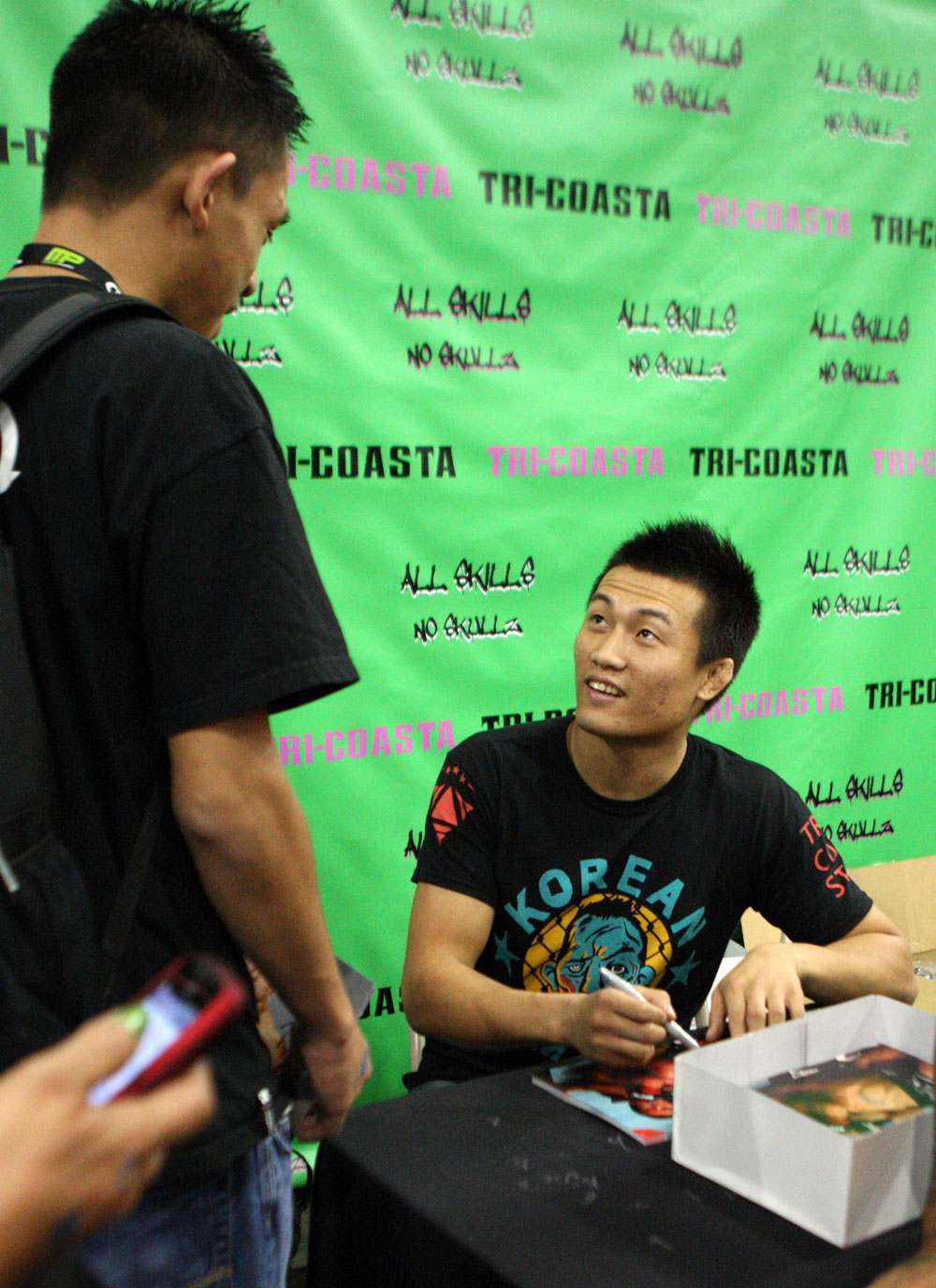 """The Korean Zombie"" Chan Sung Jung signs autographs"