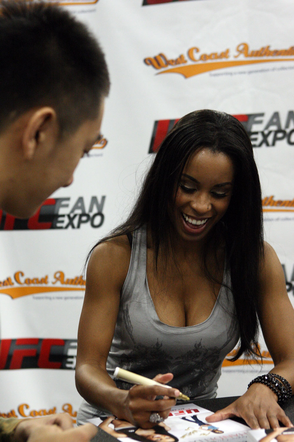 Octagon Girl Chandella Powell signs autographs