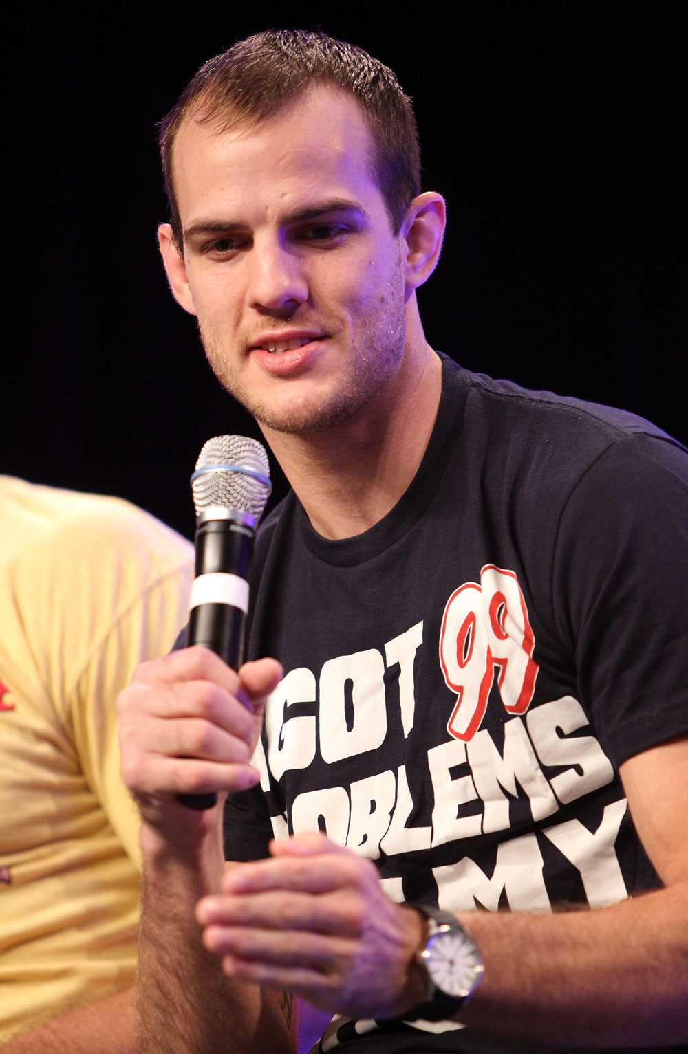 UFC fighter Cole Miller attends a Q&A session with former cast members of The Ultimate Fighter on the main stage at the UFC Fan Expo