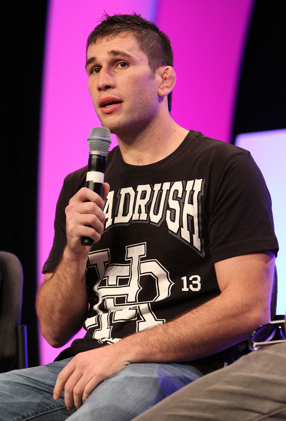 UFC fighter Amir Sadollah attends a Q&A session with former cast members of The Ultimate Fighter on the main stage at the UFC Fan Expo