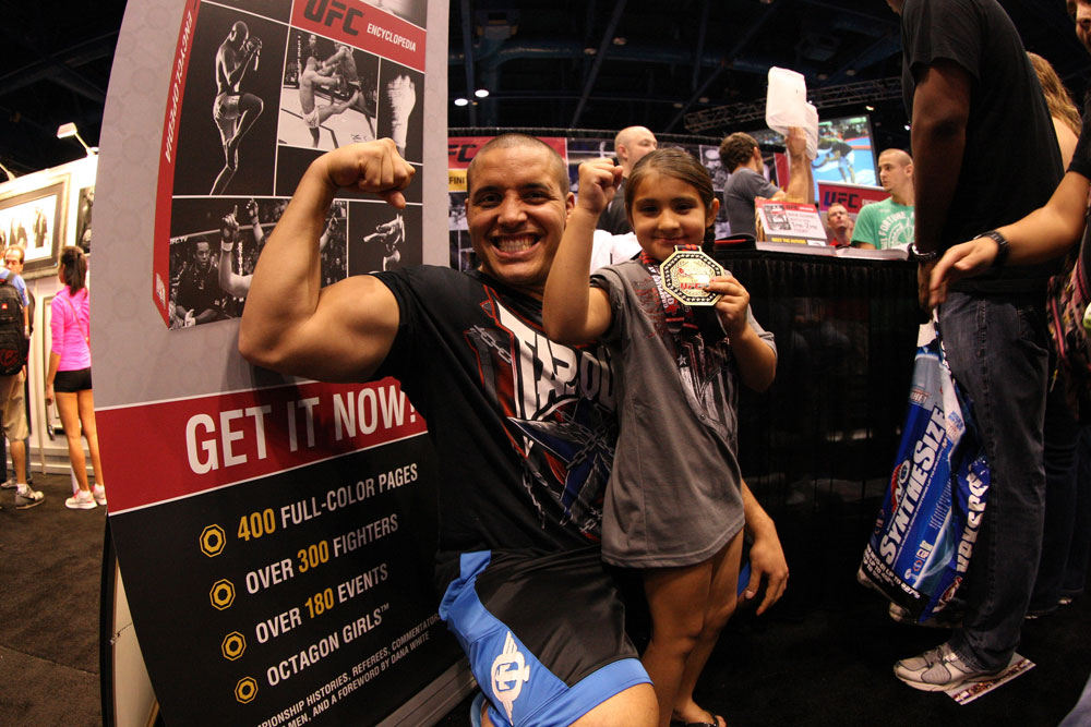 UFC fighter Pat Barry poses for a photo with a young fan at the UFC Fan Expo
