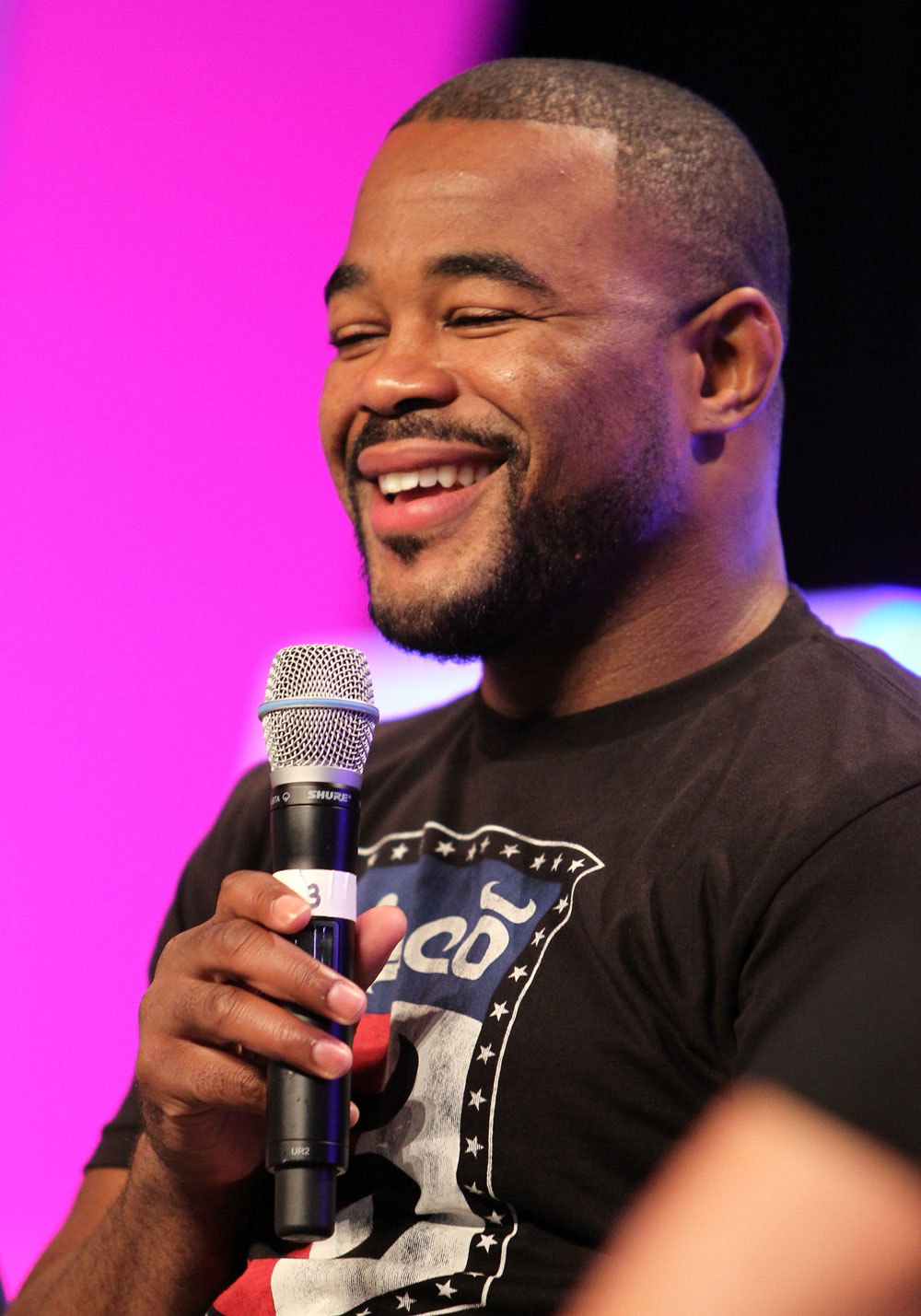 UFC fighter Rashad Evans attends a Q&amp;A session with former cast members of The Ultimate Fighter on the main stage at the UFC Fan Expo