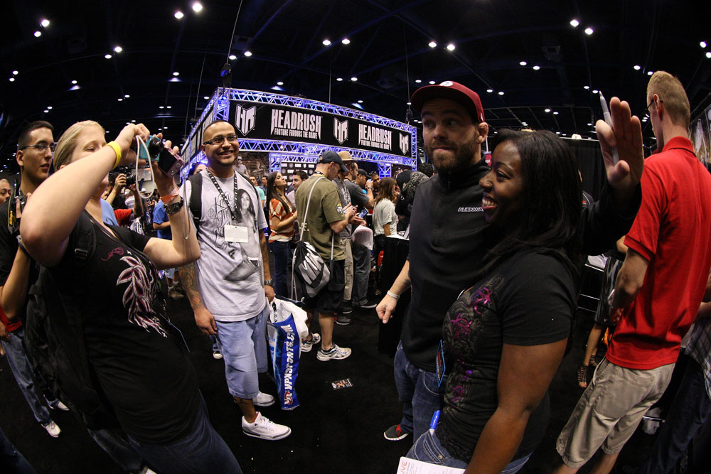 Former UFC Champion Jens Pulver poses for photos with fans at the UFC Fan Expo