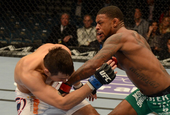 Michael Johnson strikes Myles Jury at UFC 155
