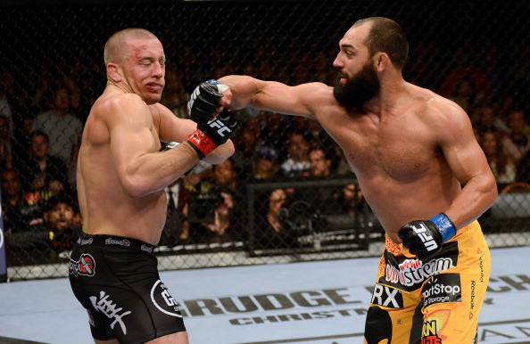 Hendricks lands a right against St-Pierre