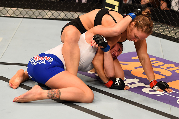 (Top) Ronda Rousey grapples with Cat Zingano in their championship bout during the UFC 184 event on February 28, 2015 in Los Angeles, California. (Photo by Josh Hedges/Zuffa LLC)