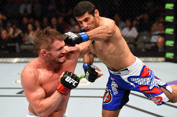 Beneil Dariush throws a flying superman punch against <a href='../fighter/Daron-Cruickshank'>Daron Cruickshank</a> in their lightweight bout during the UFC 185 event at the American Airlines Center on March 14, 2015 in Dallas, TX. (Photo by Josh Hedges/Zuffa LLC)