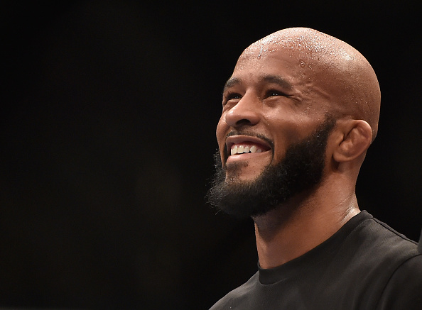 LAS VEGAS, NV - SEPTEMBER 27:  UFC Flyweight champion Demetrious Johnson celebrates after his win over Chris Cariaso after their flyweight championship fight during the UFC 178 event inside the MGM Grand Garden Arena on September 27, 2014 in Las Vegas, Nevada.  (Photo by Jeff Bottari/Zuffa LLC/Zuffa LLC via Getty Images)