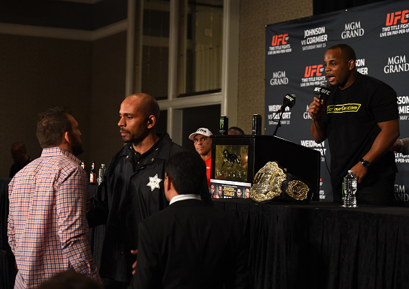 LAS VEGAS, NEVADA - MAY 23: (R-L) Daniel Cormier and Ryan Bader exchange words during the UFC 187 post-fight press conference inside the MGM Grand Hotel & Casino on May 23, 2015 in Las Vegas, Nevada. (Photo by Brandon Magnus/Zuffa LLC/Zuffa LLC via Getty Images)