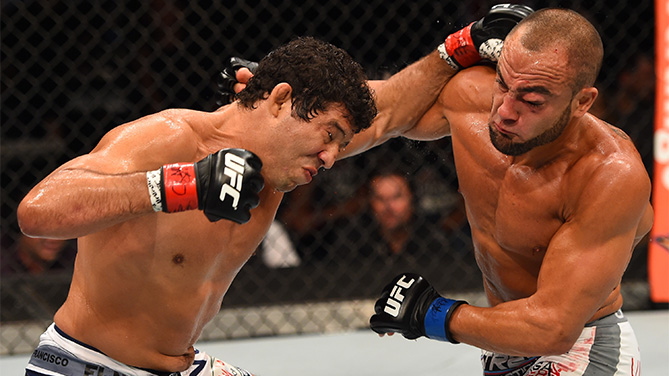 MEXICO CITY, MEXICO - JUNE 13: (L-R) Gilbert Melendez of the United States punches Eddie Alvarez of the United Statesin their lightweight bout during the UFC 188 event at the Arena Ciudad de Mexico. (Photo by Josh Hedges/Zuffa LLC)