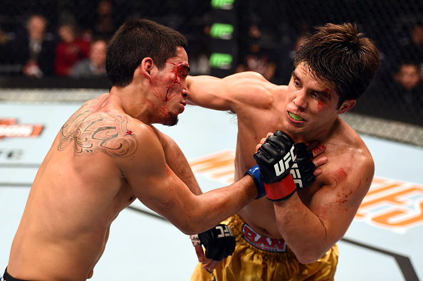 PHOENIX, AZ - DECEMBER 13:  (R-L) Henry Cejudo punches <a href='../fighter/Dustin-Kimura'>Dustin Kimura</a> in their bantamweight fight during the <a href='../event/UFC-Silva-vs-Irvin'><a href='../event/saturday-august-23'><a href='../event/saturday-september-19'><a href='../event/saturday-september-26'><a href='../event/tbd-october'><a href='../event/saturday-november-7'><a href='../event/saturday-november-21'><a href='../event/saturday-december-12'><a href='../event/saturday-december-19'>UFC Fight Night </a></a></a></a></a></a></a></a></a>event at the U.S. Airways Center.  (Photo by Josh Hedges/Zuffa LLC)
