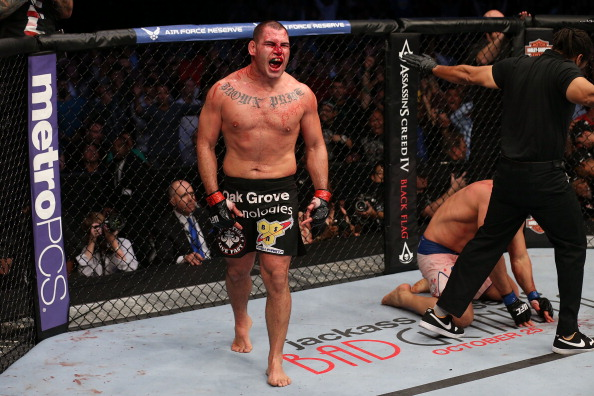 HOUSTON, TEXAS - OCT. 19:  Cain Velasquez  celebrates after defeating <a href='../fighter/Junior-Dos-Santos'>Junior Dos Santos</a> at UFC 166. (Photo by Nick Laham/Zuffa LLC)