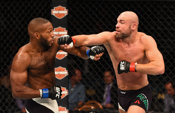 (R-L) Cathal Pendred punches John Howard in their welterweight fight during the UFC 189 event inside MGM Grand Garden Arena on July 11, 2015 in Las Vegas, Nevada. (Josh Hedges/Zuffa LLC)