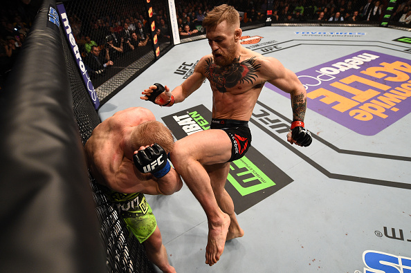 Conor McGregor of Ireland lands a knee to the head of Dennis Siver of Germany in their featherweight fight during the UFC Fight Night event at the TD Garden on January 18, 2015 in Boston, Massachusetts. (Photo by Jeff Bottari/Zuffa LLC)