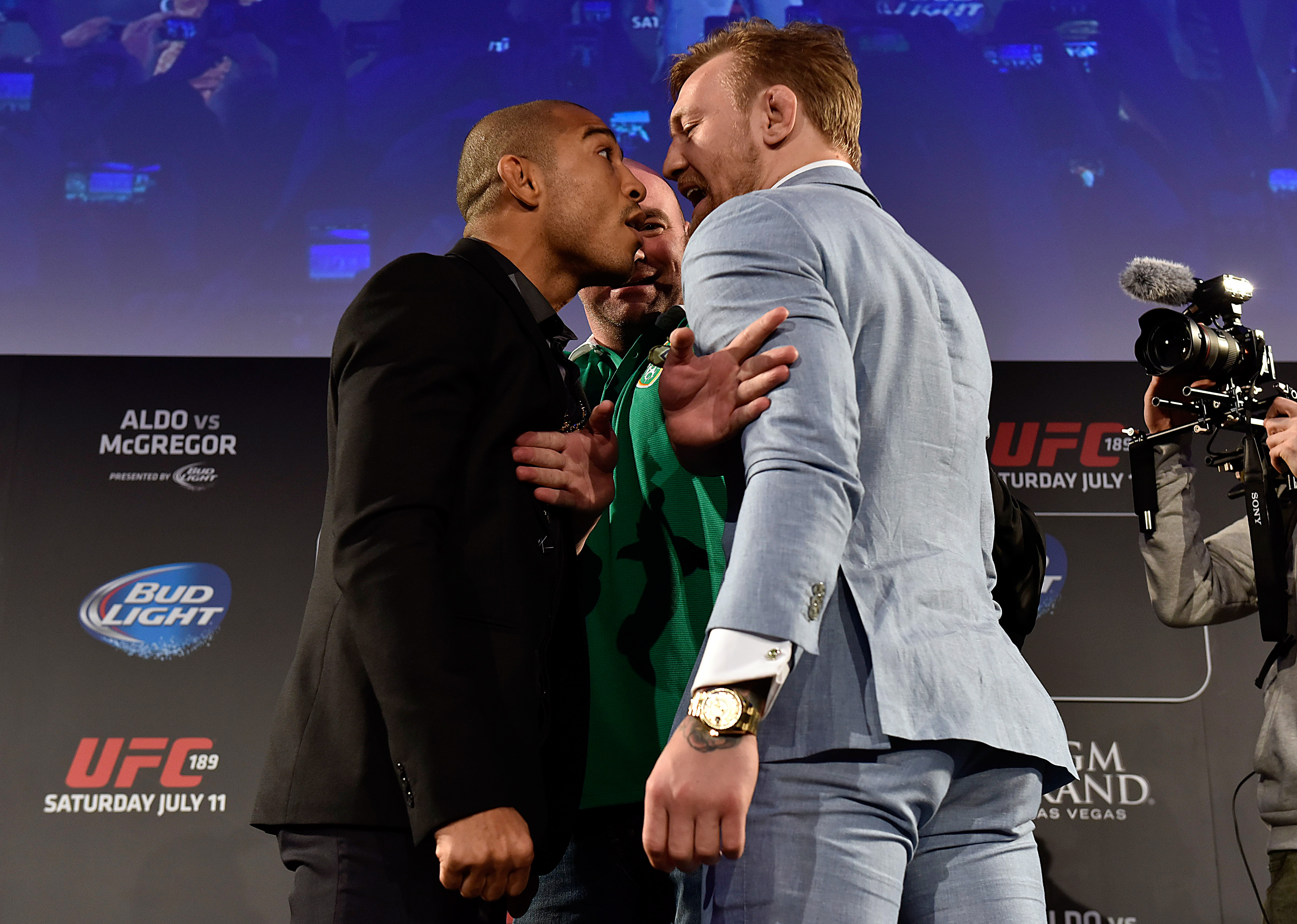 UFC President Dana White (C) separates UFC Featherweight Champion Jose Aldo of Brazil (L) and title challenger Conor 'The Notorious' McGregor of Ireland (R) as they face off during the UFC 189 World Championship Fan Event on March 31, 2015 in Dublin, Ireland. (Photo by Jeff Bottari/Zuffa LLC)
