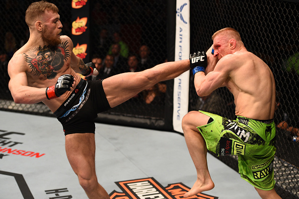 Conor McGregor of Ireland kicks Dennis Siver of Germany in their featherweight fight during the UFC Fight Night event at the TD Garden on January 18, 2015 in Boston, Massachusetts. (Photo by Jeff Bottari/Zuffa LLC)
