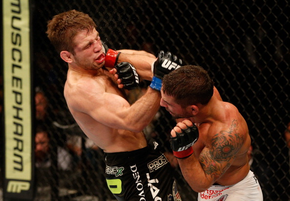 Chad Mendes punches Nik Lentz in their featherweight bout during the UFC on FOX event at Sleep Train Arena on December 14, 2013 in Sacramento, California. (Photo by Josh Hedges/Zuffa LLC)