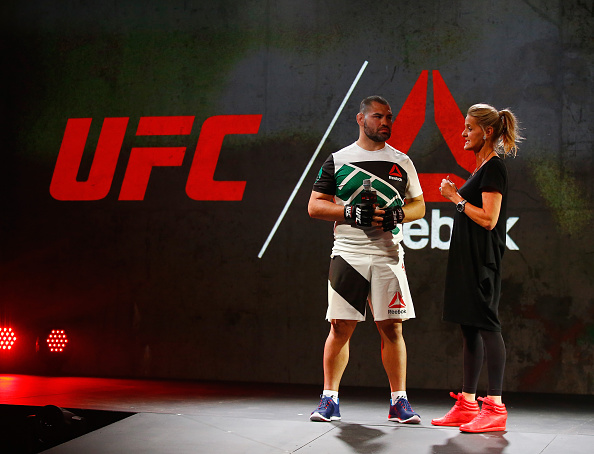 UFC champion Cain Velasquez speaks to Reebok design expert Corinna Werkle during the Reebok Fight Kit Launch at Skylight Modern. (Photo by Al Bello/Zuffa LLC)