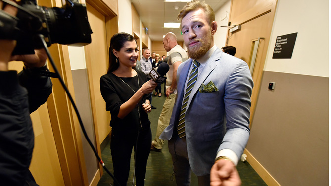 Conor 'The Notorious' McGregor of Ireland is interviewed by UFC host Megan Olivi during the UFC 189 World Championship Fan Event on March 31, 2015 in Dublin, Ireland. (Photo by Jeff Bottari/Zuffa LLC)