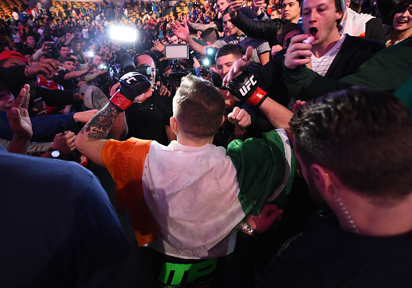 Conor McGregor of Ireland celebrates with the crowd after defeating Dennis Siver of Germany in their featherweight fight during the UFC Fight Night event at the TD Garden on January 18, 2015 in Boston, Massachusetts. (Photo by Jeff Bottari/Zuffa LLC)