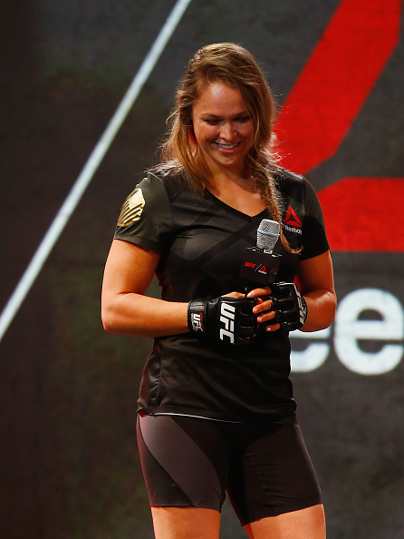 UFC champion <a href='../fighter/Ronda-Rousey'>Ronda Rousey</a> speaks to Reebok design expert Corinna Werkle during the Reebok Fight Kit Launch at Skylight Modern. (Photo by Al Bello/Zuffa LLC)
