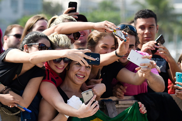 Women's bantamweight contender Bethe Correia of Brazil poses with fans during open training session at Pepe Beach on July 29, 2015 in Rio de Janeiro, Brazil. (Photo by Buda Mendes/Zuffa LLC)
