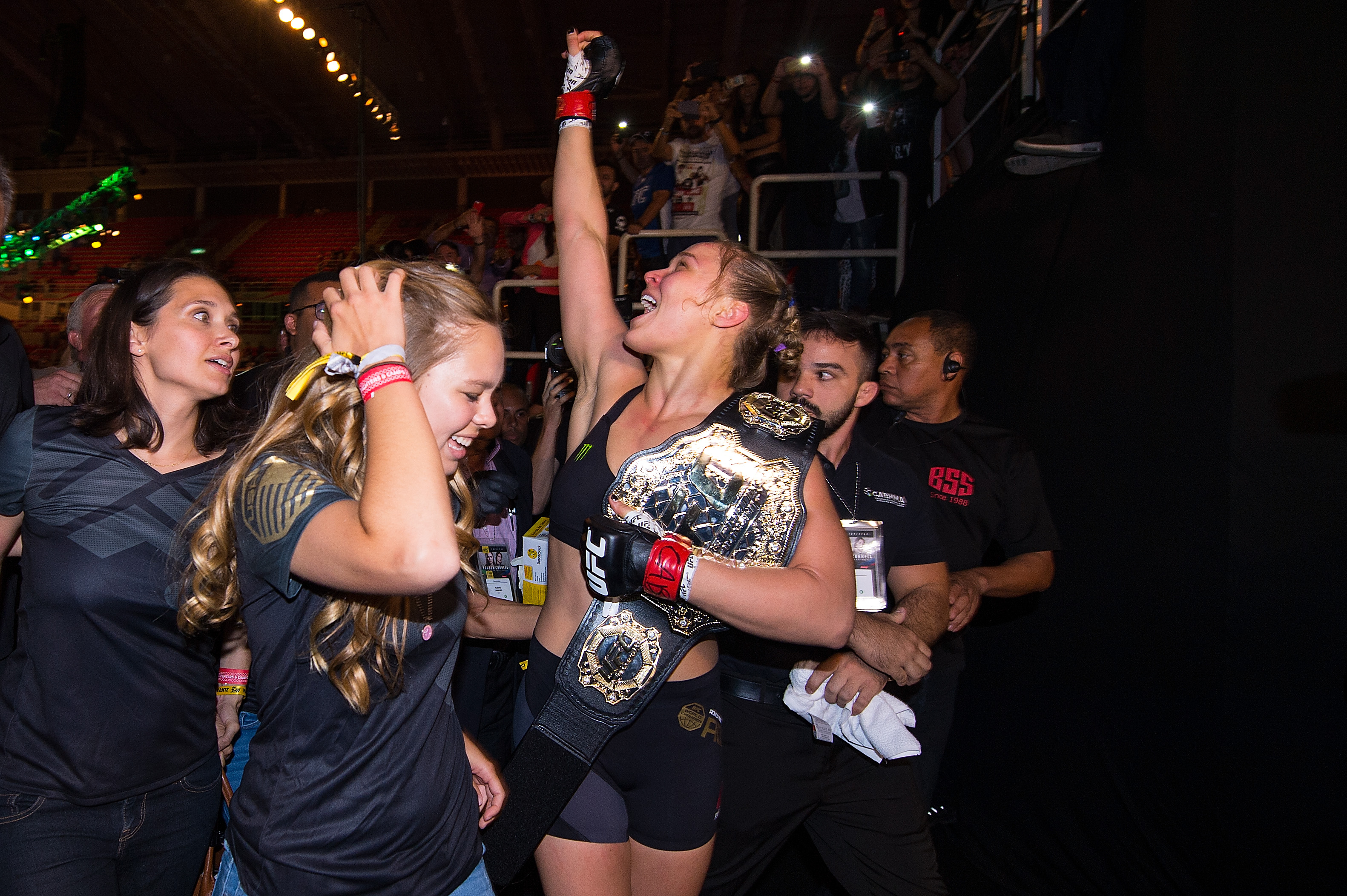 RIO DE JANEIRO, BRAZIL - AUGUST 01: UFC women's bantamweight champion Ronda Rousey celebrates with her family and fans backstage after defeating Bethe Correira of Brazil by KO during the UFC 190 event inside HSBC Arena on August 1, 2015 in Rio de Janeiro, Brazil. (Photo by Jeff Bottari/Zuffa LLC)