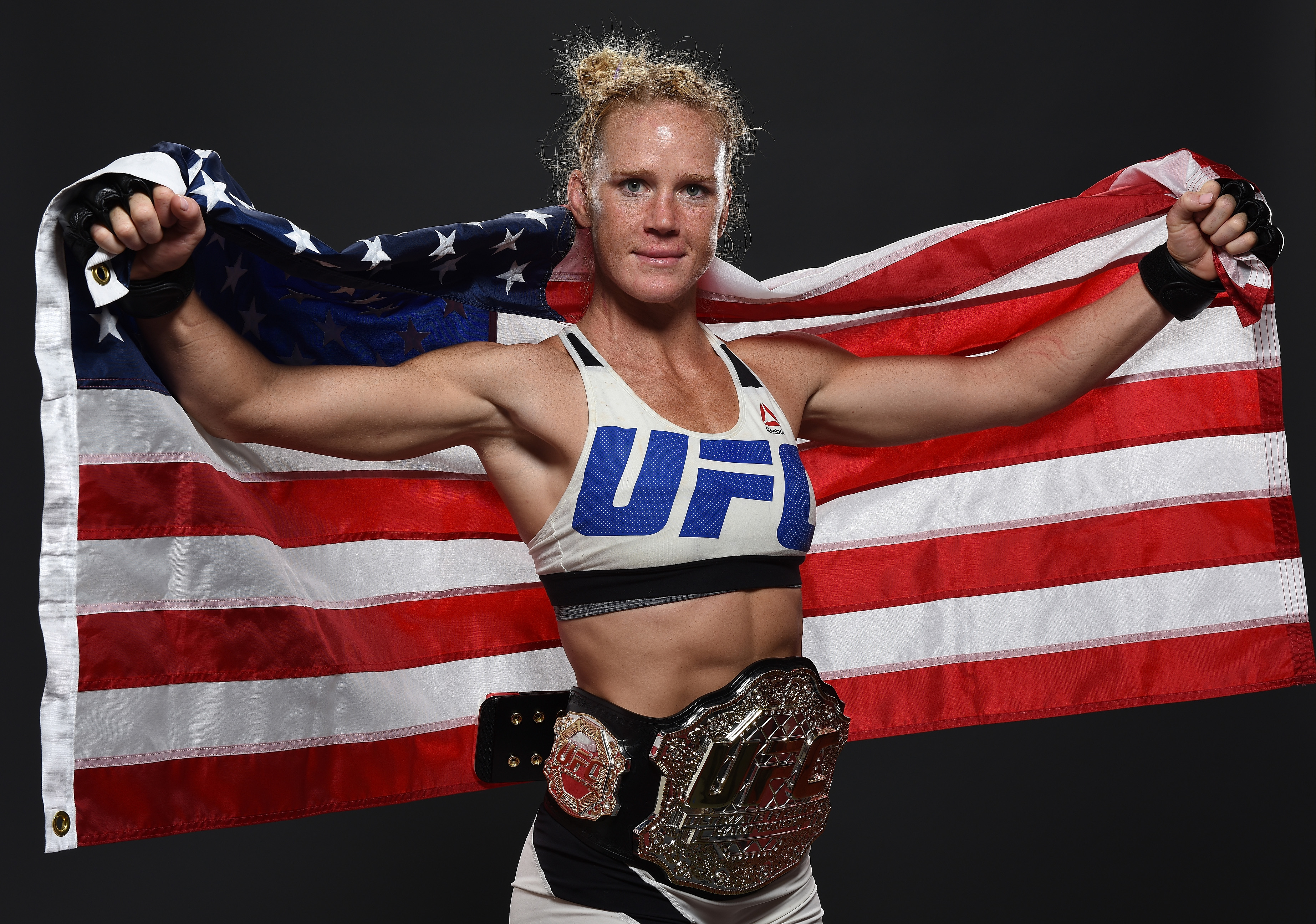 UFC women's bantamweight champion Holly Holm poses backstage for a post-fight portrait after the UFC 193 event at Etihad Stadium on November 15, 2015 in Melbourne, Australia. Holly Holm defeated Ronda Rousey by KO in second round. (Photo by Mike Roach/Zuffa LLC)