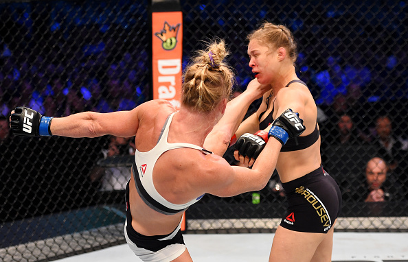 MELBOURNE, AUSTRALIA - NOV. 15: (L-R) Holly Holm lands a left-high kick against Ronda Rousey in the second round of their UFC women's bantamweight championship bout during the UFC 193 event at Etihad Stadium. (Photo by Josh Hedges/Zuffa LLC)