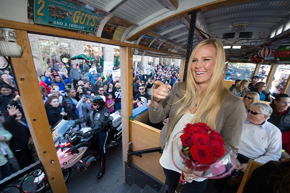UFC women's bantamweight champion Holly Holm waves to her hometown crowd during the UFC Champion Holly Holm Welcome Home Parade AT Civic Plaza on December 6, 2015 in Albuquerque, New Mexico. (Photo by Brandon Magnus/Zuffa LLC)