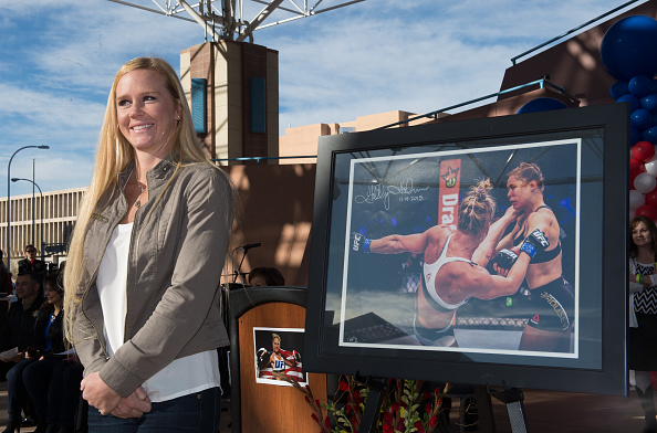 UFC women's bantamweight champion Holly Holm auctions one of her photos during the UFC Champion Holly Holm Welcome Home Parade at Civic Plaza on December 6, 2015 in Albuquerque, New Mexico. (Photo by Brandon Magnus/Zuffa LLC)