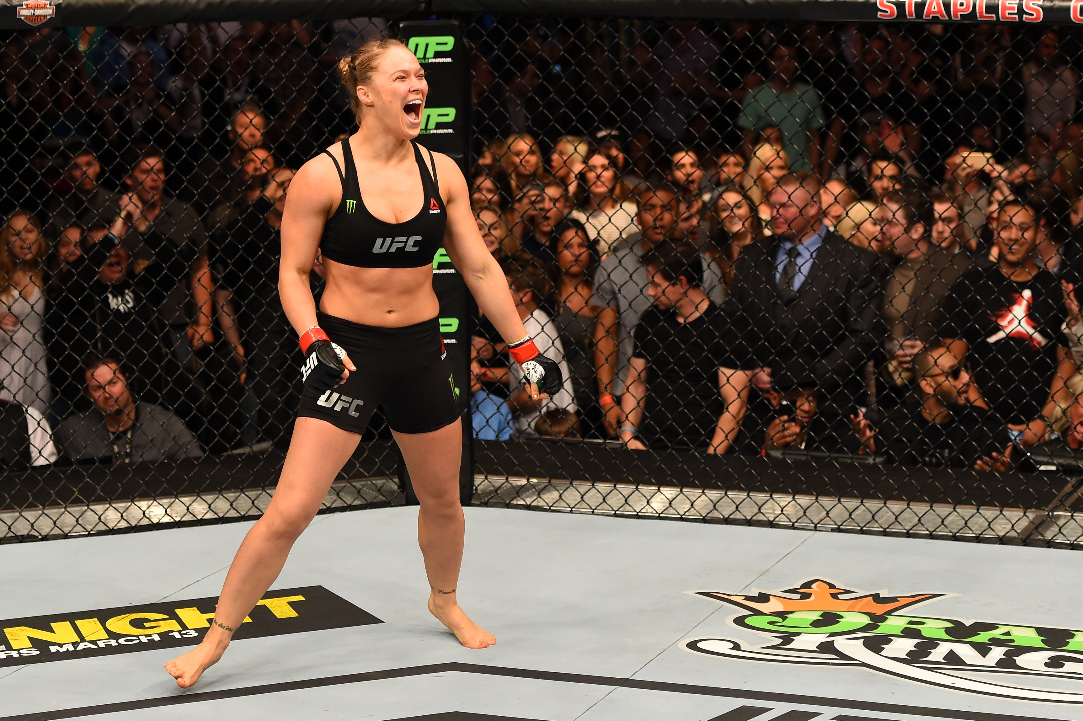 Rousey celebrates a victory over Cat Zingano in the bantamweight championship bout at UFC 184 in February in Los Angeles. Rousey is undefeated in her 12 professional fights, winning eleven in the first round.
