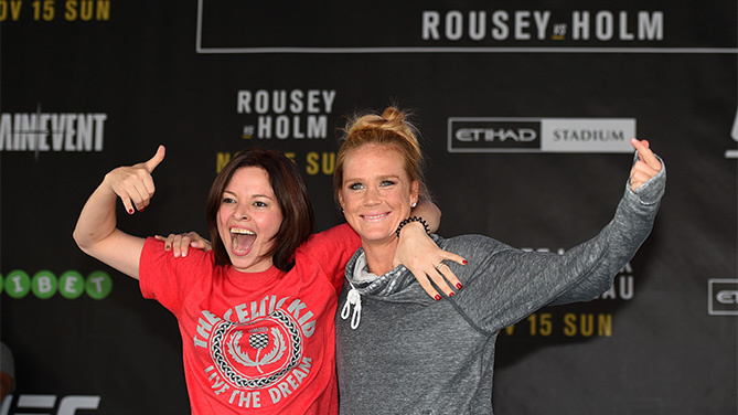 MELBOURNE, AUSTRALIA - NOVEMBER 12:  Holly Holm of the United States brings a fan on stage to help with her open workout for fans and media at Federation Square on November 12, 2015 in Melbourne, Australia. (Photo by Josh Hedges/Zuffa LLC)