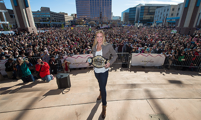 UFC women's bantamweight champion Holly Holm takes a picture with her hometown crowd during the UFC Champion Holly Holm Welcome Home Parade AT Civic Plaza on December 6, 2015 in Albuquerque, New Mexico. (Photo by Brandon Magnus/Zuffa LLC)