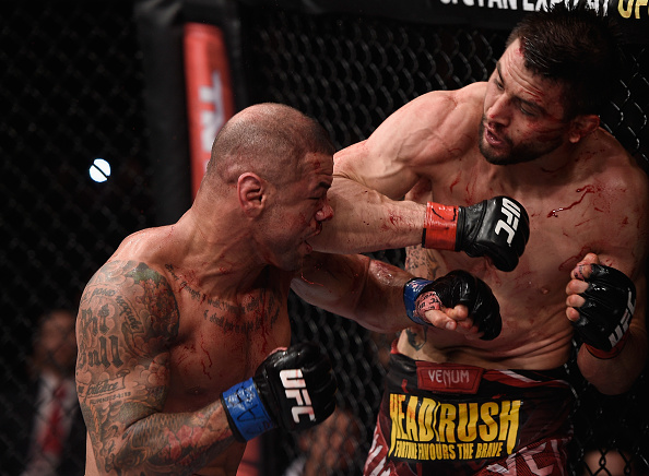 Carlos Condit of the United States punches Thiago Alves of Brazil in their welterweight UFC bout during the UFC Fight Night event at Arena Goiania on May 30, 2015 in Goiania, Brazil.(Buda Mendes/Zuffa LLC)