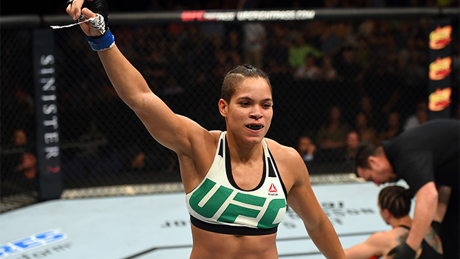 (L-R) Amanda Nunes of Brazil celebrates after defeating Sara McMann in their women's bantamweight bout during the UFC Fight Night event at Bridgestone Arena on August 8, 2015 in Nashville, Tennessee.  (Photo by Josh Hedges/Zuffa LLC)