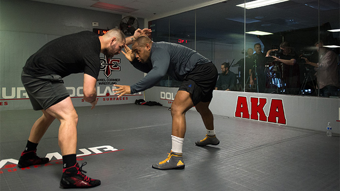 (L-R) Cain Velasquez works out with light heavyweight champion Daniel Cormier during a media day at American Kickboxing Academy on January 5, 2016 in San Jose, California. (Photo by Brandon Magnus/Zuffa LLC)