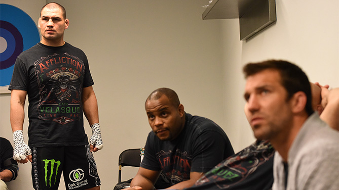 (L-R) Cain Velasquez warms up in his locker room backstage with team mates Daniel Cormier and Luke Rockhold during the UFC 188 event at the Arena Ciudad de Mexico on June 13, 2015 in Mexico City, Mexico. (Photo by Mike Roach/Zuffa LLC)