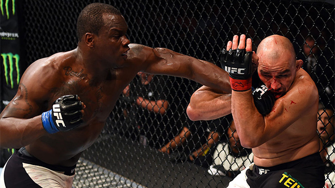 (L-R) Ovince Saint Preux punches Glover Teixeira of Brazil in their light heavyweight bout during the UFC Fight Night event at Bridgestone Arena on August 8, 2015 in Nashville, Tennessee. (Photo by Josh Hedges/Zuffa LLC)