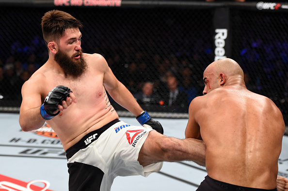 Bryan Barberena kicks Warley Alves during their fight at UFC 198