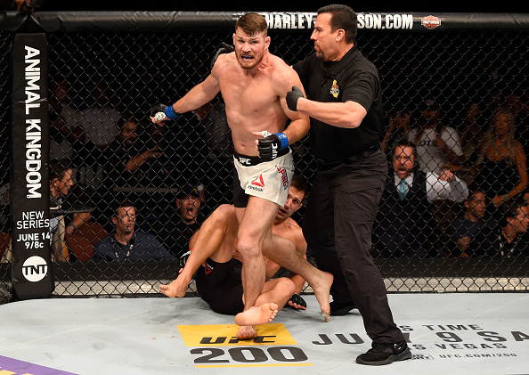 INGLEWOOD, CA - JUNE 04: <a href='../fighter/Michael-Bisping'>Michael Bisping</a> of England wins in a first round knockout against Luke Rockhold in their UFC middleweight championship bout during the UFC 199 event at The Forum. (Photo by Josh Hedges/Zuffa LLC)