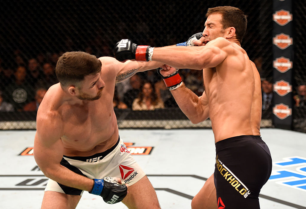 INGLEWOOD, CA - JUNE 04: Michael Bisping throws a left punch against Luke Rockhold in their UFC middleweight championship bout during the UFC 199 event at The Forum. (Photo by Josh Hedges/Zuffa LLC)
