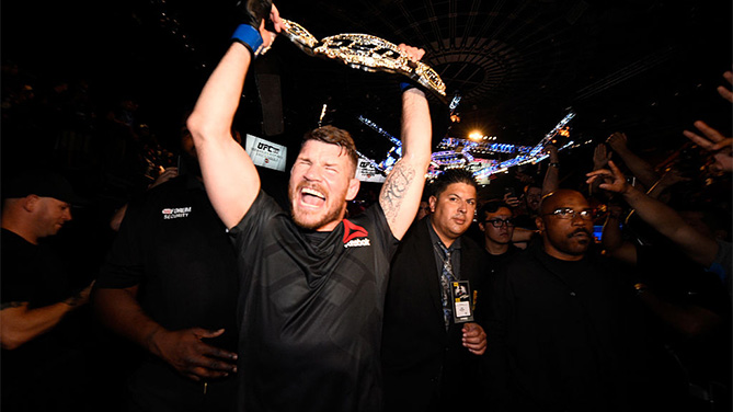 Michael Bisping celebrates after winning the UFC middleweight title at UFC 199
