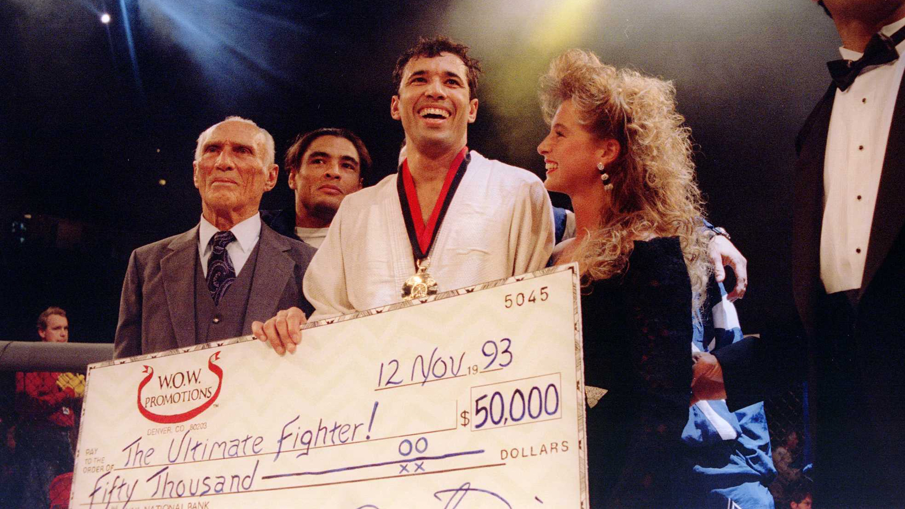 Jiu-Jitsu black belt Royce Gracie (USA) receives a $50,000 check after becoming