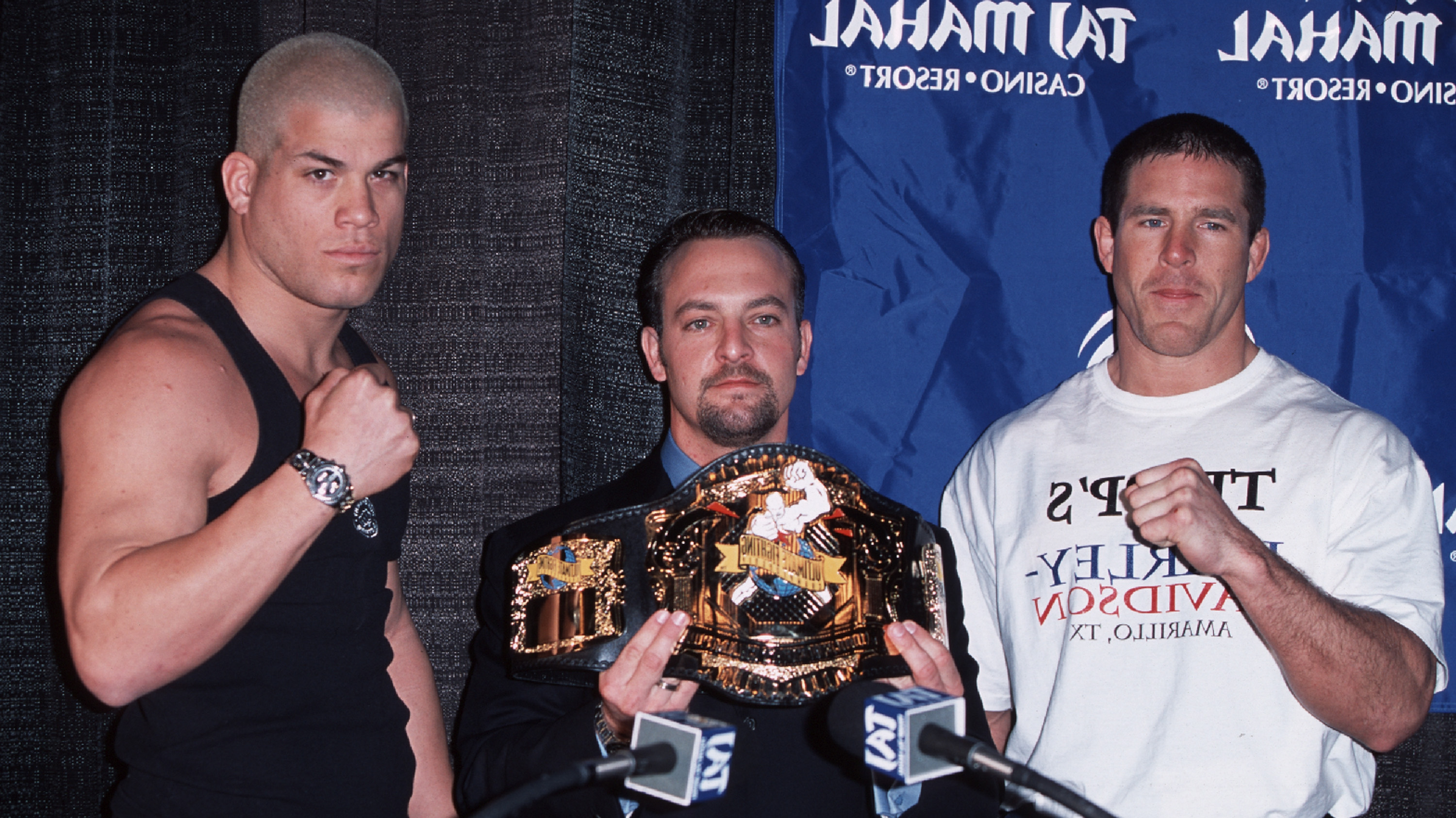 UFC CEO Lorenzo Fertitta (middle) stands in between UFC 30 opponents Tito Ortiz and Evan Tanner during the first-ever UFC event under the Zuffa banner.