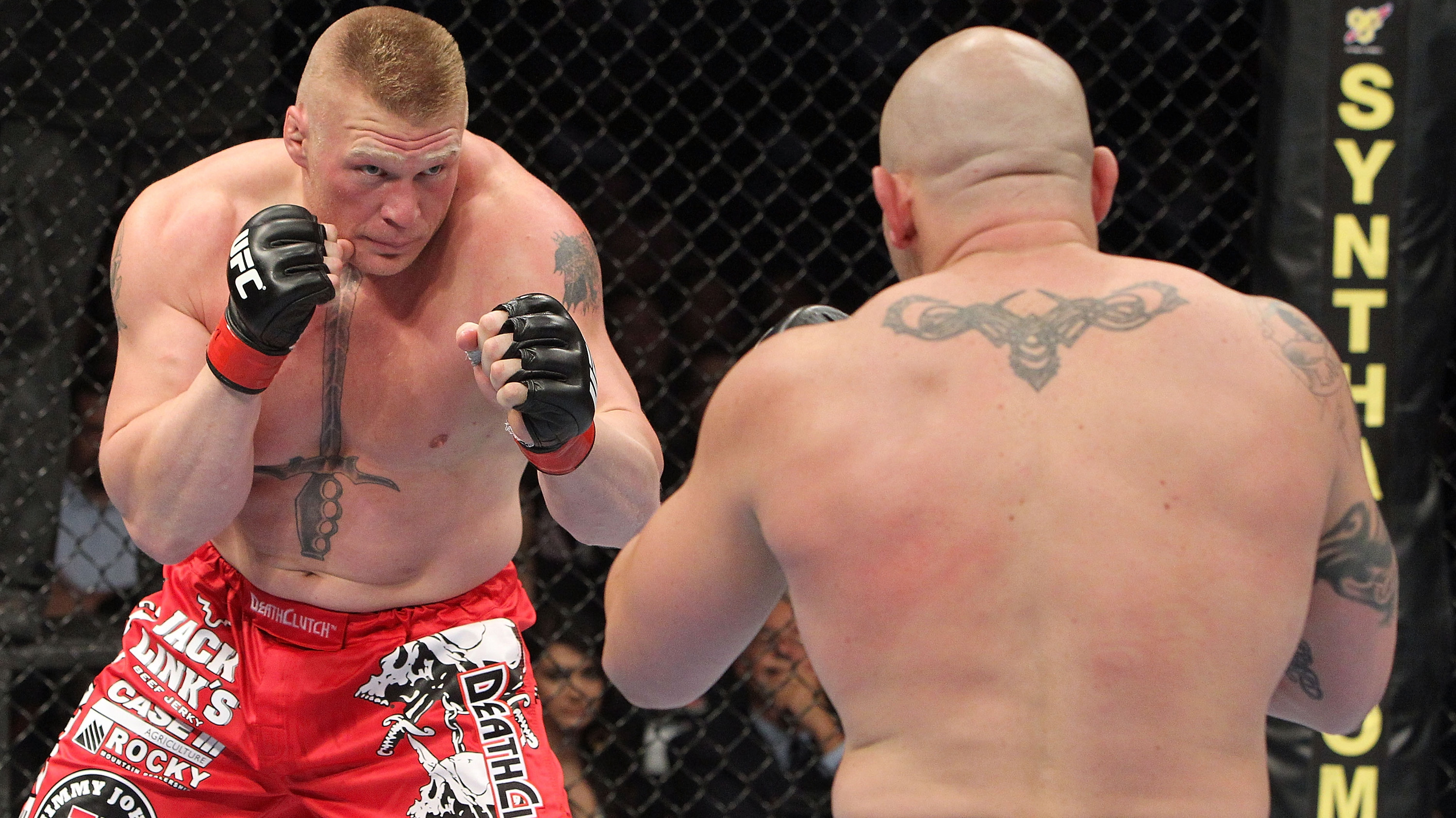 LAS VEGAS - JULY 03: (L-R) Brock Lesnar takes on <a href='../fighter/Shane-Carwin'>Shane Carwin</a> during the UFC Heavyweight Championship Unification bout at the MGM Grand Garden Arena on July 3, 2010 in Las Vegas, Nevada. (Photo by Josh Hedges/Zuffa LLC)